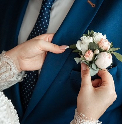 Boutonniere for the groom. The concept of marriage, family relationships, wedding paraphernalia.